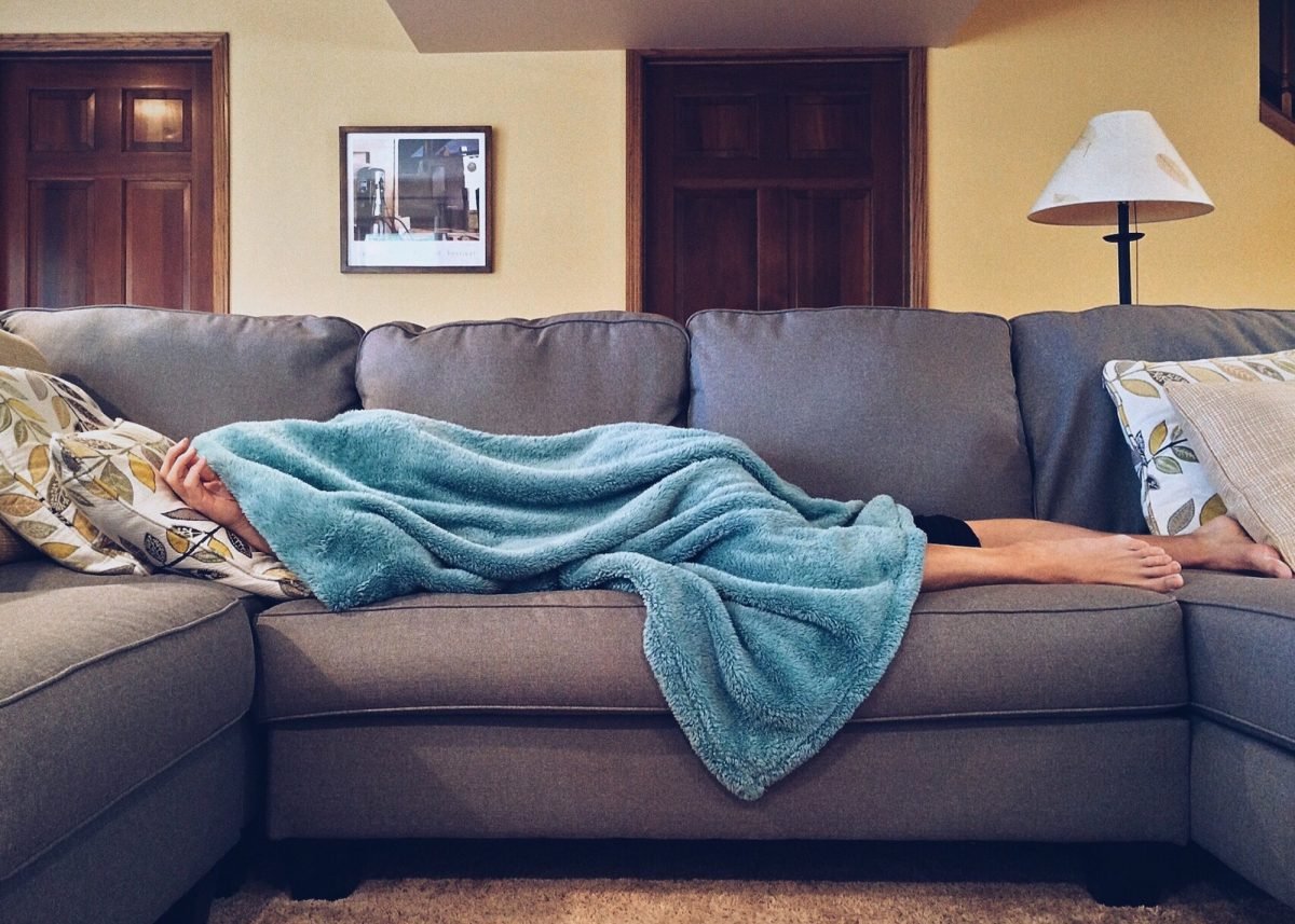 person sleeping on sofa