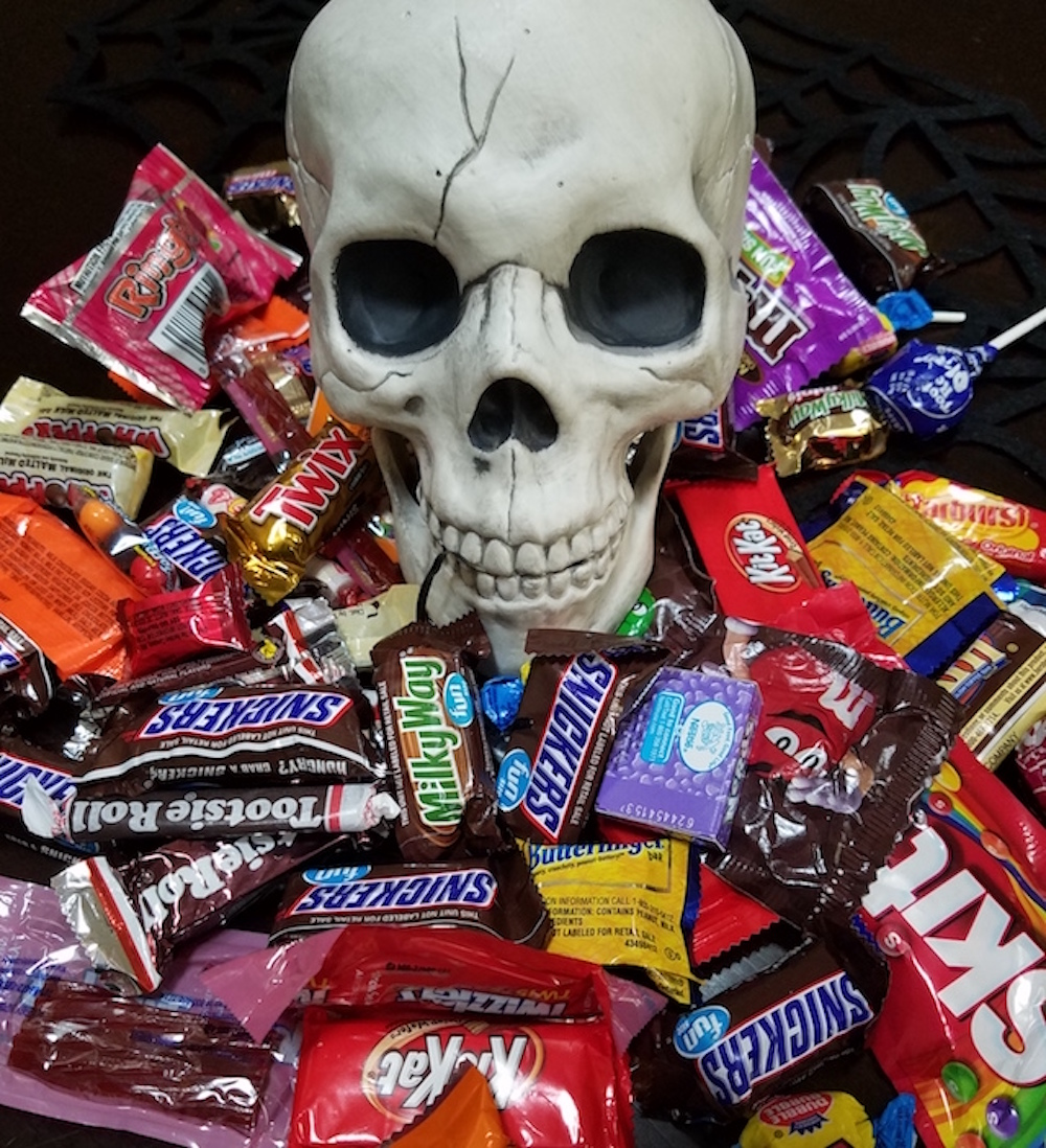 Halloween candy and skull