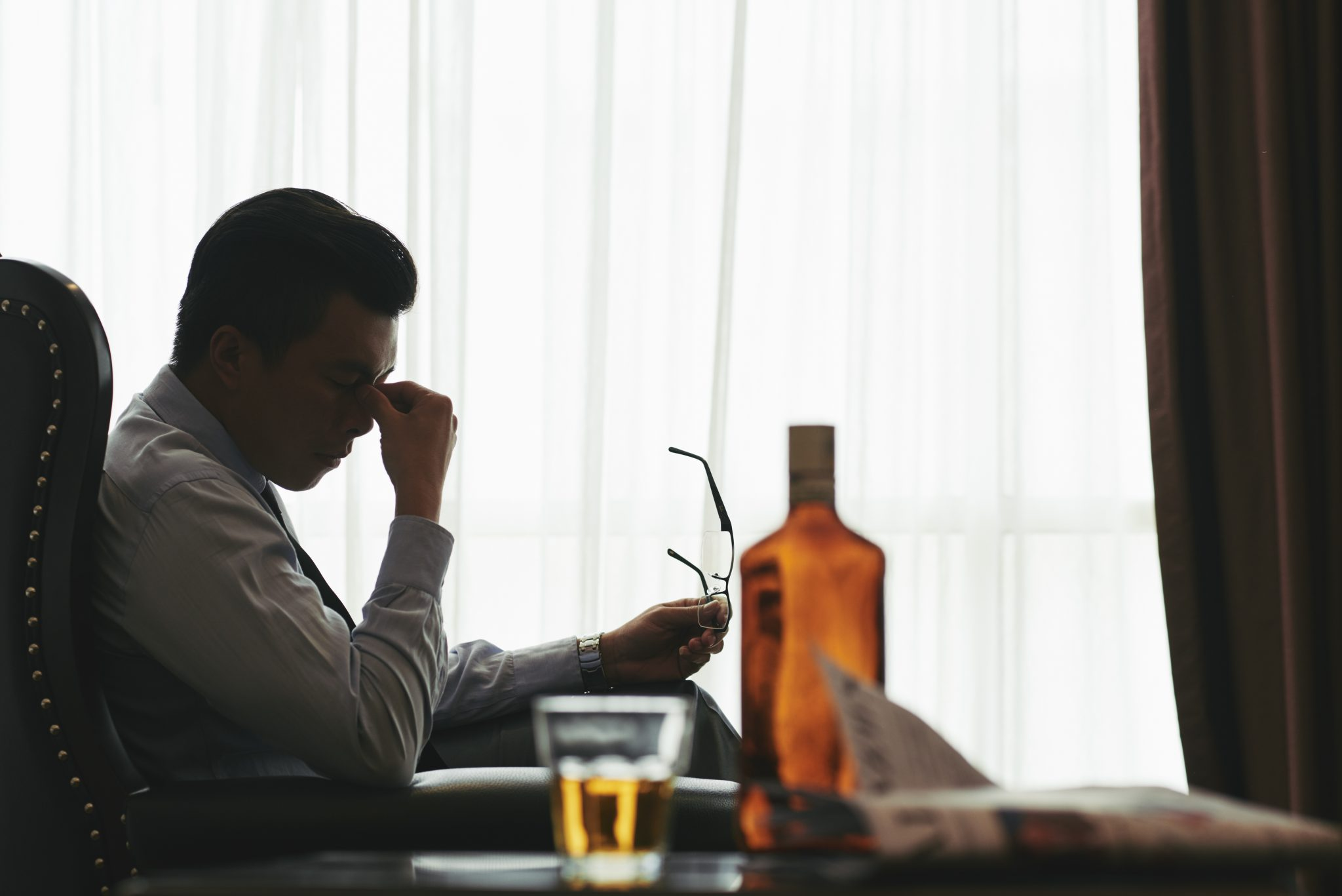 Stressed man with whiskey