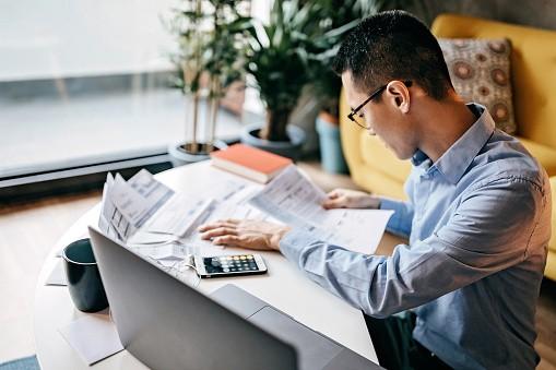 Man looking at tax forms