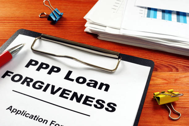 PPP Loan Forgiveness Application Form on clipboard